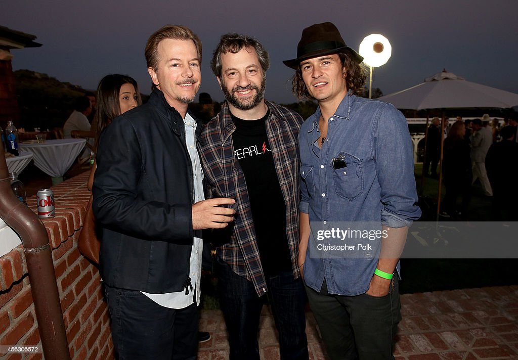 Actor David Spade, producer Judd Apatow and actor Orlando Bloom attend Rock4EB, Malibu, with Jackson Browne & David Spade sponsored by Suja Juice & Sabra Hummus at Private Residence on September 28, 2014 in Malibu, California.