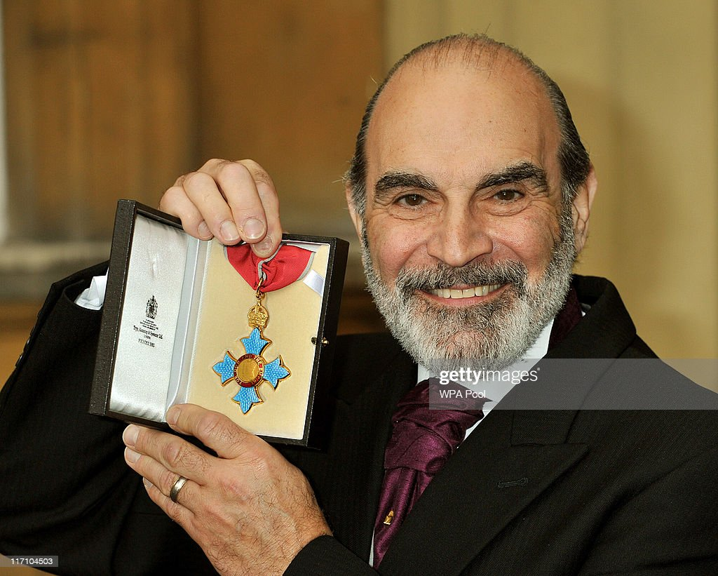 Actor <a gi-track='captionPersonalityLinkClicked' href=/galleries/search?phrase=David+Suchet&family=editorial&specificpeople=654814 ng-click='$event.stopPropagation()'>David Suchet</a> holds his CBE after it was presented to him by the Prince of Wales, at the Investiture Ceremony on June 23, 2011 at Buckingham Palace, London.