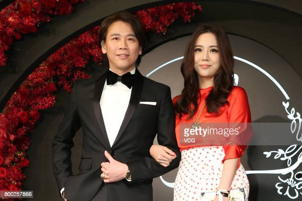 Actor David Tao and wife Penny Chiang arrive at the red carpet of the banquet held by Macau businessman Levo Chan and actress Ady An on June 23 2017...