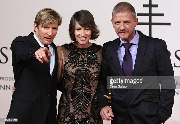 Actor David Wenham actress Johanna Wokalek and director Soenke Wortmann attend the world premiere of 'Pope Joan' at the Sony Center CineStar on...