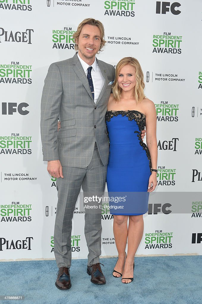 Actor Dax Shepard (L) and actress Kristen Bell attend the 2014 Film Independent Spirit Awards at Santa Monica Beach on March 1, 2014 in Santa Monica, California.