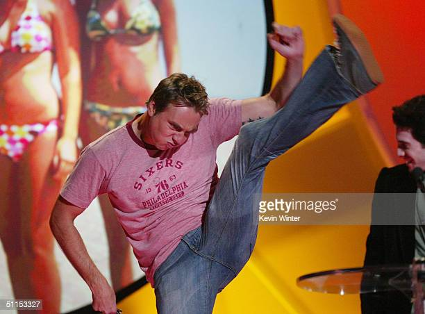 Actor Dax Shepard kicks his leg up in the air as actor Seth Green looks on stage at The 2004 Teen Choice Awards held on August 8 2004 at Universal...