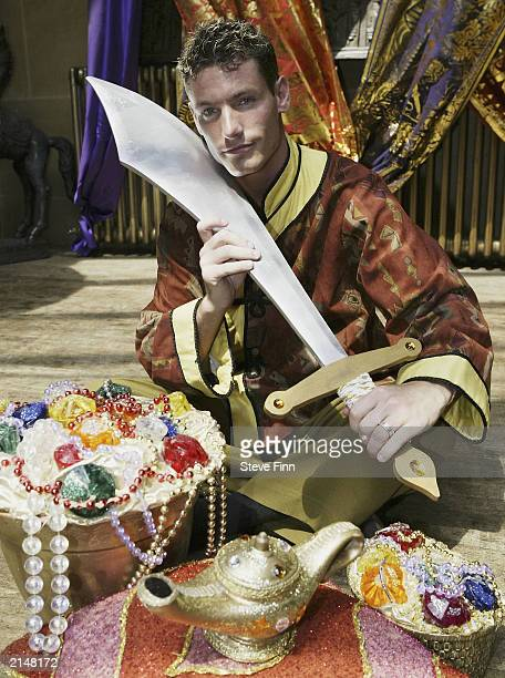 Actor Dean Gaffney poses with props to promote the pantomime 'Aladdin' July 9 2003 in Croydon England 'Aladdin' will be showing over Christmas 2003...