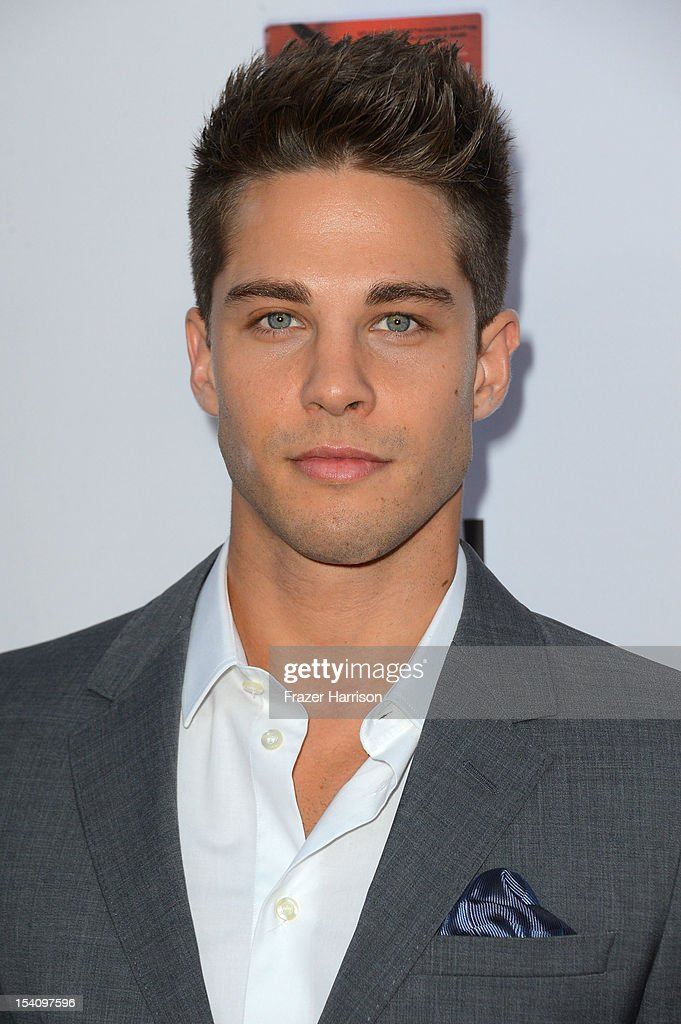 Actor Dean Geyer arrives at the Premiere Screening of FX's 'American Horror Story Asylum' at the Paramount Theatre on October 13 2012 in Hollywood...