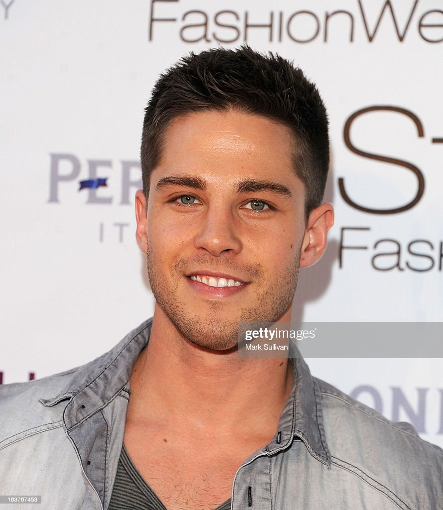 Actor Dean Geyer arrives for the Madisonpark Collective 2013 Fashion Show at Vibiana on March 14 2013 in Los Angeles California