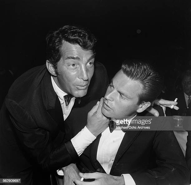 Actor Dean Martin talks with actor Robert Wagner during an event in Los Angeles California
