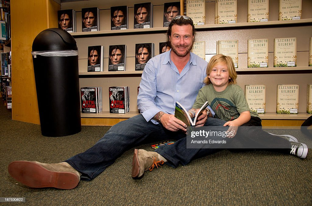 Actor <a gi-track='captionPersonalityLinkClicked' href=/galleries/search?phrase=Dean+McDermott&family=editorial&specificpeople=4486413 ng-click='$event.stopPropagation()'>Dean McDermott</a> and his son <a gi-track='captionPersonalityLinkClicked' href=/galleries/search?phrase=Liam+McDermott&family=editorial&specificpeople=4975632 ng-click='$event.stopPropagation()'>Liam McDermott</a> attend Tori Spelling's book signing of her new book 'Spelling It Like It Is' at Barnes & Noble bookstore at The Grove on November 9, 2013 in Los Angeles, California.