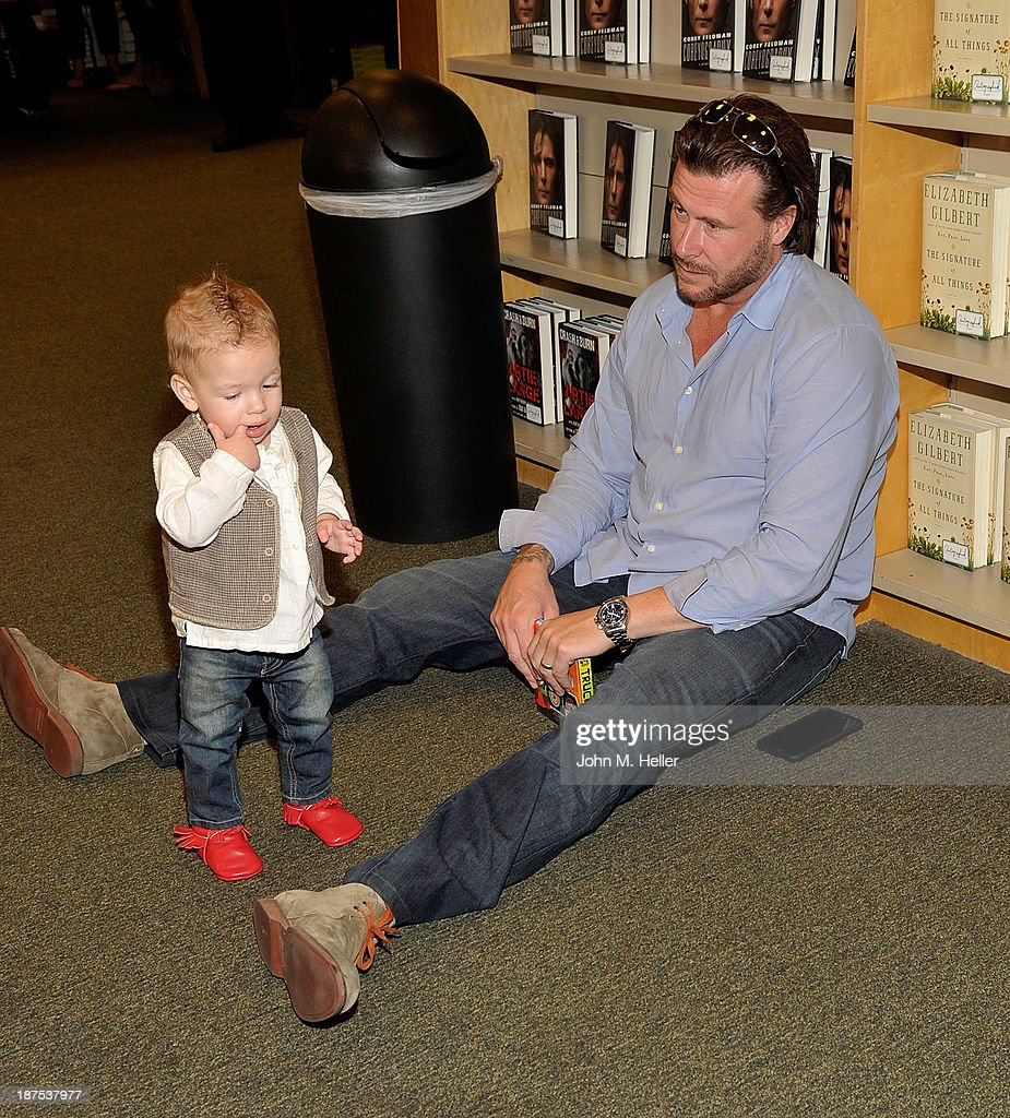 Actor <a gi-track='captionPersonalityLinkClicked' href=/galleries/search?phrase=Dean+McDermott&family=editorial&specificpeople=4486413 ng-click='$event.stopPropagation()'>Dean McDermott</a> with his son Finn McDermott at the Tori Spelling book signing for her new book 'Spelling It Like It Is' at the Barnes & Noble bookstore at The Grove on November 9, 2013 in Los Angeles, California.