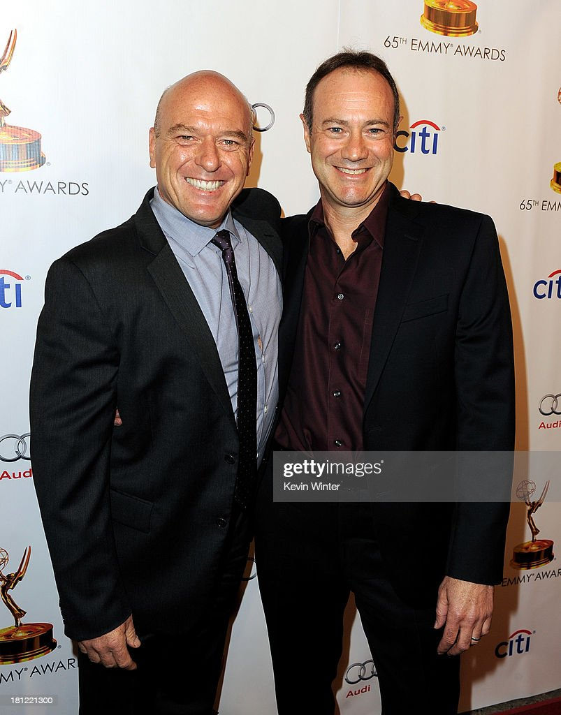 Actor <a gi-track='captionPersonalityLinkClicked' href=/galleries/search?phrase=Dean+Norris&family=editorial&specificpeople=4195761 ng-click='$event.stopPropagation()'>Dean Norris</a> (L) and writer George Mastras of Breaking Bad arrive at the 65th Primetime Emmy Awards Writer Nominees reception at the Academy of Television Arts & Sciences on September 19, 2013 in No. Hollywood, California.