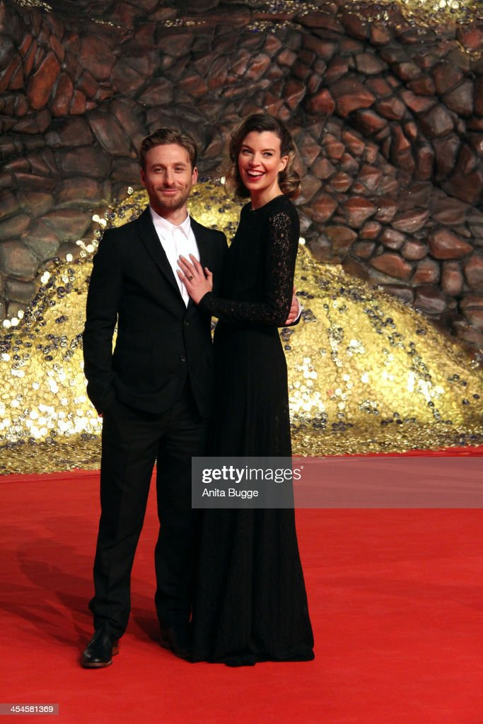 Actor <a gi-track='captionPersonalityLinkClicked' href=/galleries/search?phrase=Dean+O%27Gorman&family=editorial&specificpeople=845835 ng-click='$event.stopPropagation()'>Dean O'Gorman</a> and guest attend the 'The Hobbit: The Desolation of Smaug' European Premiere at Cinestar on December 9, 2013 in Berlin, Germany.