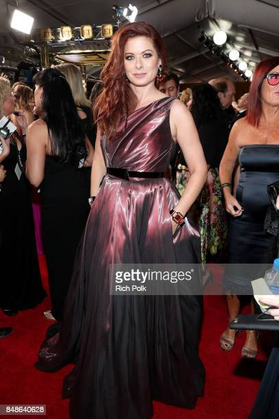 Actor Debra Messing walks the red carpet during the 69th Annual Primetime Emmy Awards at Microsoft Theater on September 17 2017 in Los Angeles...