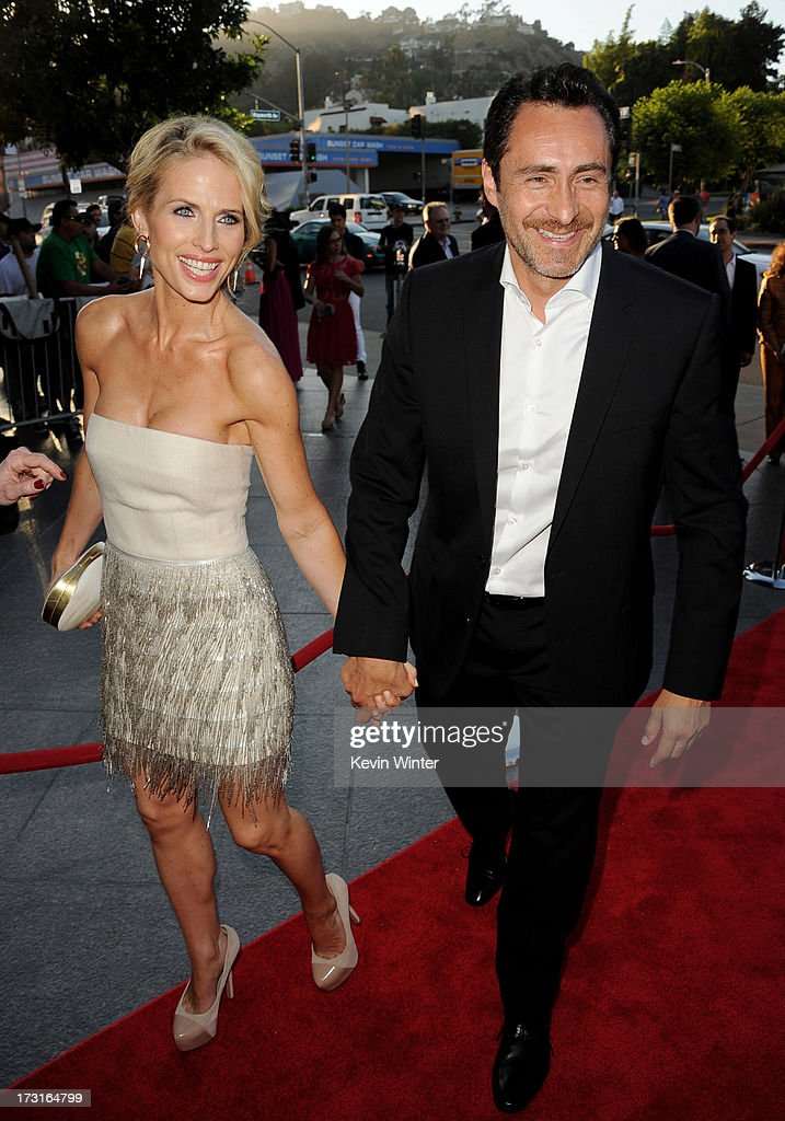 Actor Demian Bichir (R) and his wife Lisset arrive at the series premiere of FX's 'The Bridge' at the Directors Guild of America on July 8, 2013 in Los Angeles, California.