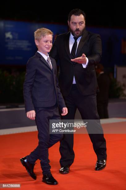 Actor Denis Menochet and actor Thomas Gioria attend the premiere of the movie 'Jusqu'à la Garde' presented in competition at the 74th Venice Film...