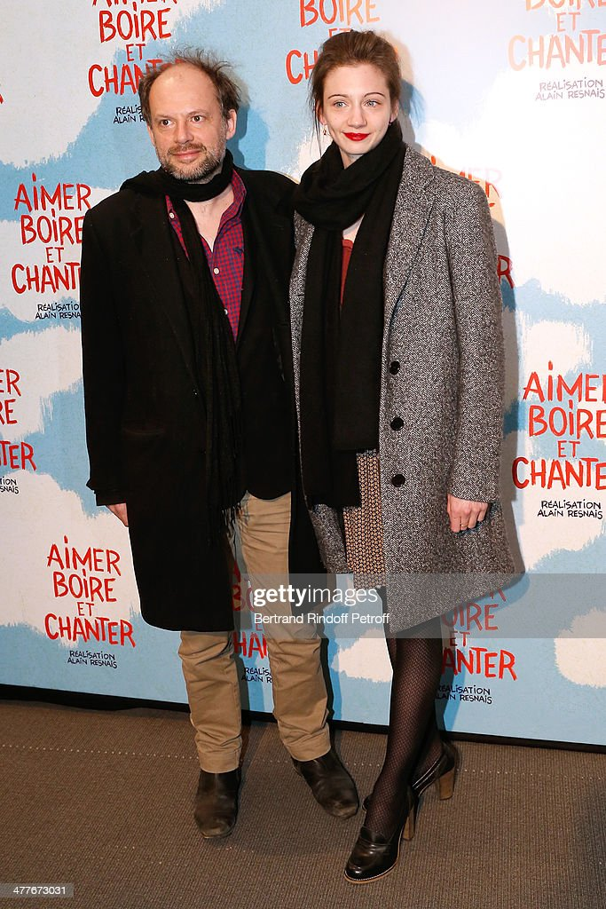 Actor Denis Podalydes and Leslie Menu attend the 'Aimer, Boire Et Chanter' Paris movie premiere. Held at Cinema UGC Normandie on March 10, 2014 in Paris, France.