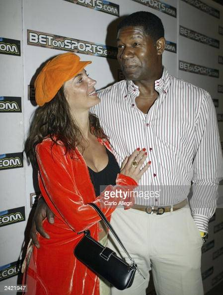 Actor Dennis Haysbert and girlfriend Sandra Vidal arrive for the 2nd Annual BETonSPORTScom Carnival Party August 23 2003 in San Jose Costa Rica...