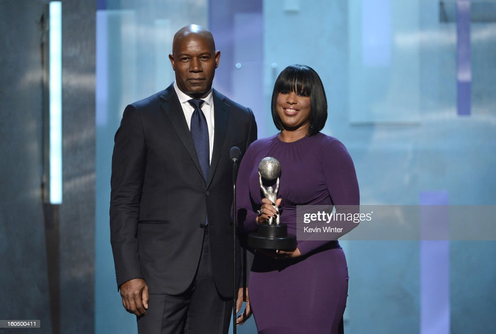 Actor Dennis Haysbert (L) and NAACP Chairman of the National Board of Directors Roslyn M. Brock speak onstage during the 44th NAACP Image Awards at The Shrine Auditorium on February 1, 2013 in Los Angeles, California.
