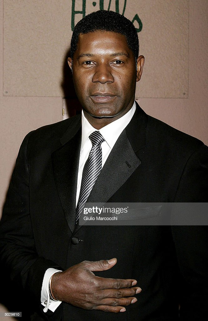 Actor Dennis Haysbert arrives at the 13th Annual Night of 100 Stars Oscar Viewing Black Tie Gala, February 29, 2004 at the Beverly Hills Hotel in Beverly Hills, California.