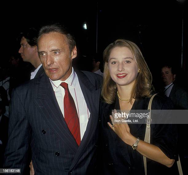 Actor Dennis Hopper and wife Katherine LaNasa attend the premiere of 'Big Top Pee Wee' on July 21 1988 at Mann Chinese Theater in Hollywood California