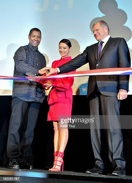 Actor Denzel Washington Actress Emi Takei Director Robert Zemeckis attend the 'Flight' Japan Premiere ribbon cutting ceremony at Marunouchi...