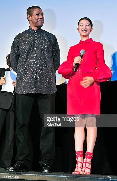 Actor Denzel Washington and Actress Emi Takei attend the 'Flight' Japan Premiere at Marunouchi Piccadilly on February 21 2013 in Tokyo Japan The film...