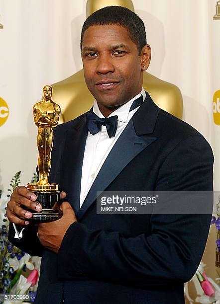 US actor Denzel Washington holds his Oscar after winning the award for best actor in a leading role for his portrayal of Alonzo a narcotics officer...
