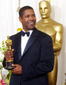US actor Denzel Washington holds his Oscar for best actor in a leading role for his portrayal of Alonzo a narcotics officer who has crossed the...