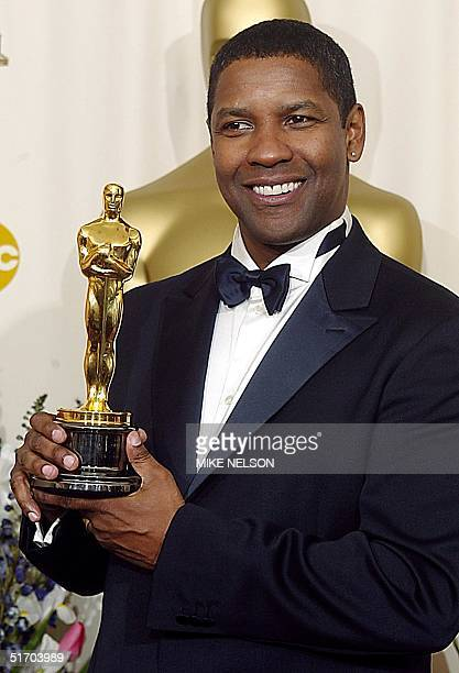 US actor Denzel Washington holds the Oscar after winning the award for best actor in a leading role for his portrayal of Alonzo a narcotics officer...