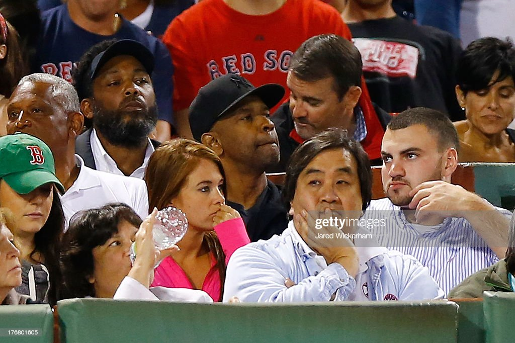 Actor Denzel Washington looks on during the game between the Boston Red Sox and the New York Yankees on August 18, 2013 at Fenway Park in Boston, Massachusetts.