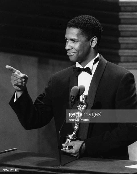 Actor Denzel Washington on stage winning his Best Supporting Actor Oscar for the film 'Glory' at the 62nd Academy Awards Hollywood CA March 26th 1990