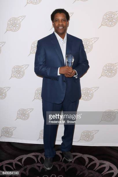 Actor Denzel Washington poses with his Motion Picture Showman of the Year Award backstage at the 54th Annual International Cinematographers Guild...