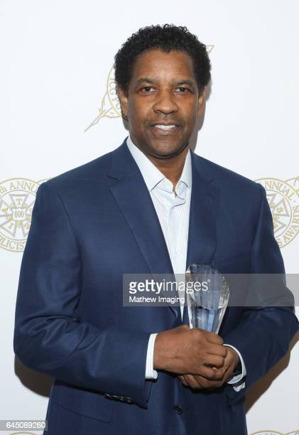 Actor Denzel Washington poses with Motion Picture Showman of The Year award at the 54th Annual ICG Publicists Awards at The Beverly Hilton Hotel on...