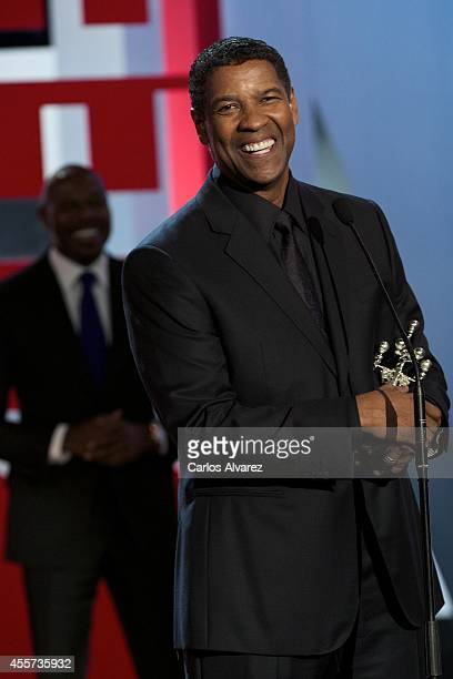 Actor Denzel Washington receives the 'Donostia' Award 2014 from director Antoine Fuqua during the 62st San Sebastian International Film Festival...