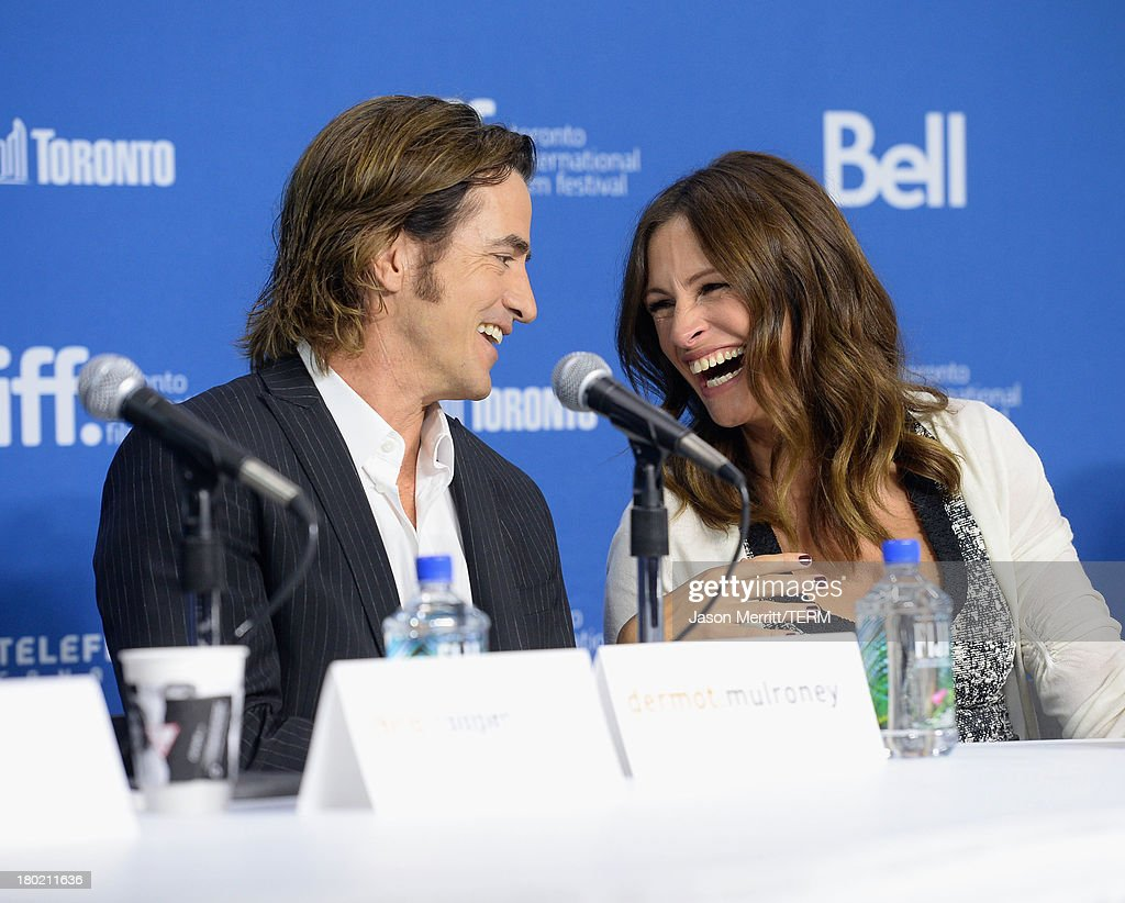 Actor <a gi-track='captionPersonalityLinkClicked' href=/galleries/search?phrase=Dermot+Mulroney&family=editorial&specificpeople=208776 ng-click='$event.stopPropagation()'>Dermot Mulroney</a> and actress <a gi-track='captionPersonalityLinkClicked' href=/galleries/search?phrase=Julia+Roberts&family=editorial&specificpeople=202605 ng-click='$event.stopPropagation()'>Julia Roberts</a> speak onstage at 'August: Osage County' Press Conference during the 2013 Toronto International Film Festival at TIFF Bell Lightbox on September 10, 2013 in Toronto, Canada.