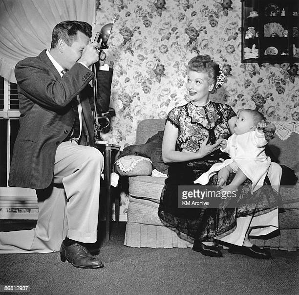 Actor Desi Arnaz photographing Lucille Ball hold their son Desi Jr California January 1953