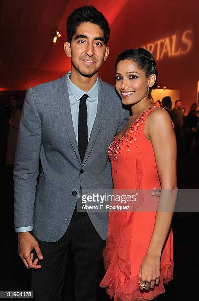 Actor Dev Patel and actress Freida Pinto attend the after party for the premiere of Relativity Media's 'Immortals' presented in RealD 3D at Nokia...