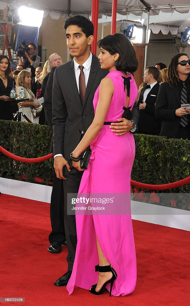 Actor Dev Patel and Actress Frieda Pinto arrives at the 19th Annual Screen Actors Guild Awards held at The Shrine Auditorium on January 27, 2013 in Los Angeles, California.