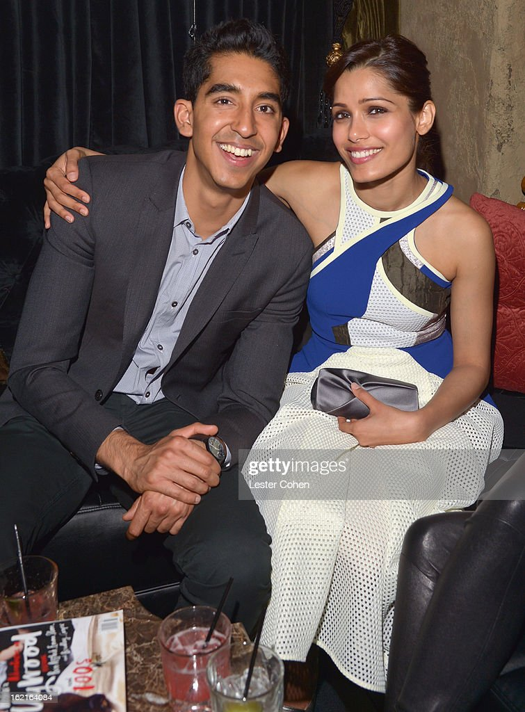 Actor <a gi-track='captionPersonalityLinkClicked' href=/galleries/search?phrase=Dev+Patel&family=editorial&specificpeople=5123545 ng-click='$event.stopPropagation()'>Dev Patel</a> and host <a gi-track='captionPersonalityLinkClicked' href=/galleries/search?phrase=Freida+Pinto&family=editorial&specificpeople=5518973 ng-click='$event.stopPropagation()'>Freida Pinto</a> attend Vanity Fair and L'Oréal Paris-hosted D.J. Night with <a gi-track='captionPersonalityLinkClicked' href=/galleries/search?phrase=Freida+Pinto&family=editorial&specificpeople=5518973 ng-click='$event.stopPropagation()'>Freida Pinto</a> in support of 10 x 10 and 'Girl Rising' at Teddy's at The Hollywood Roosevelt Hotel on February 19, 2013 in Los Angeles, California.