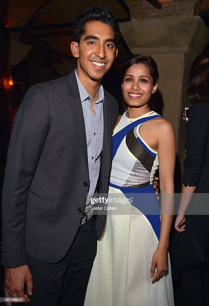 Actor Dev Patel and host Freida Pinto attend Vanity Fair and L'Oréal Paris-hosted D.J. Night with Freida Pinto in support of 10 x 10 and 'Girl Rising' at Teddy's at The Hollywood Roosevelt Hotel on February 19, 2013 in Los Angeles, California.
