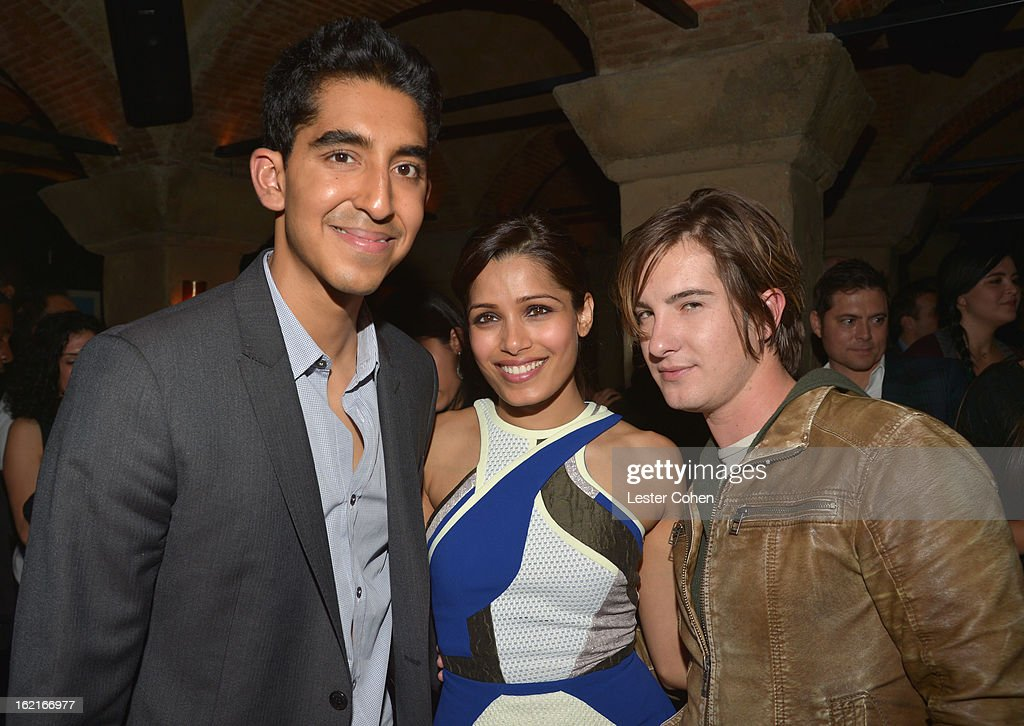 Actor Dev Patel, host Freida Pinto and actor Andrew James Allen attend Vanity Fair and L'Oréal Paris-hosted D.J. Night with Freida Pinto in support of 10 x 10 and 'Girl Rising' at Teddy's at The Hollywood Roosevelt Hotel on February 19, 2013 in Los Angeles, California.