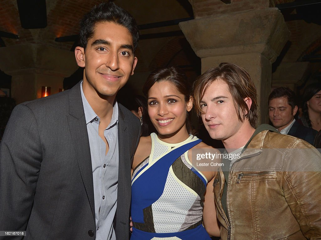 Actor <a gi-track='captionPersonalityLinkClicked' href=/galleries/search?phrase=Dev+Patel&family=editorial&specificpeople=5123545 ng-click='$event.stopPropagation()'>Dev Patel</a>, host <a gi-track='captionPersonalityLinkClicked' href=/galleries/search?phrase=Freida+Pinto&family=editorial&specificpeople=5518973 ng-click='$event.stopPropagation()'>Freida Pinto</a> and actor <a gi-track='captionPersonalityLinkClicked' href=/galleries/search?phrase=Andrew+James+Allen&family=editorial&specificpeople=4358327 ng-click='$event.stopPropagation()'>Andrew James Allen</a> attend Vanity Fair and L'Oréal Paris-hosted D.J. Night with <a gi-track='captionPersonalityLinkClicked' href=/galleries/search?phrase=Freida+Pinto&family=editorial&specificpeople=5518973 ng-click='$event.stopPropagation()'>Freida Pinto</a> in support of 10 x 10 and 'Girl Rising' at Teddy's at The Hollywood Roosevelt Hotel on February 19, 2013 in Los Angeles, California.