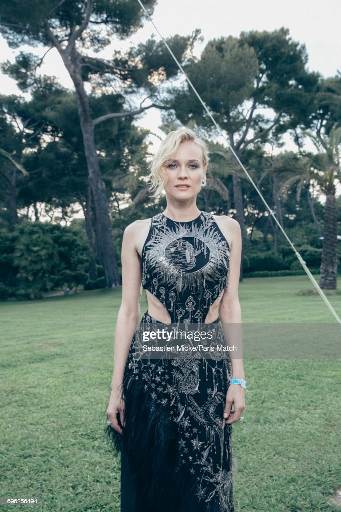 Actor Diane Kruger wearing an Alexander McQueen dress is photographed for Paris Match whilst attending the Amfar Gala at the Eden Roc Hotel on May 25, 2017 in Antibes, France.