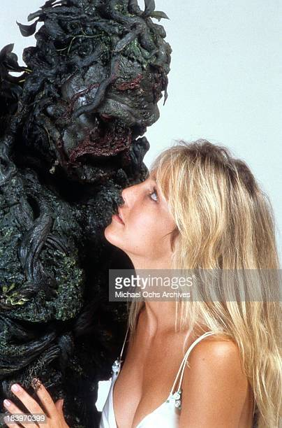Actor Dick Durock as Swamp Thing with actress Heather Locklear pose for the movie 'The Return of Swamp Thing' in 1989