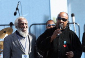 Actor Dick Gregory and musician Stevie Wonder speak onstage during the Martin Luther King Jr Memorial Dedication cochaired by the Tommy Hilfiger...