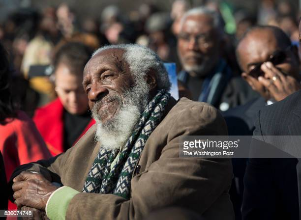 Actor Dick Gregory listens to speeches at the WreathLaying Ceremony at the Martin Luther King Jr Memorial in Washington DC on January 20 2013 It's...