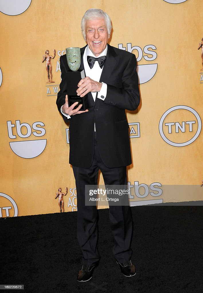 Actor <a gi-track='captionPersonalityLinkClicked' href=/galleries/search?phrase=Dick+Van+Dyke&family=editorial&specificpeople=123836 ng-click='$event.stopPropagation()'>Dick Van Dyke</a> poses in the press room at the 19th Annual Screen Actors Guild Awards held at The Shrine Auditorium on January 27, 2013 in Los Angeles, California.