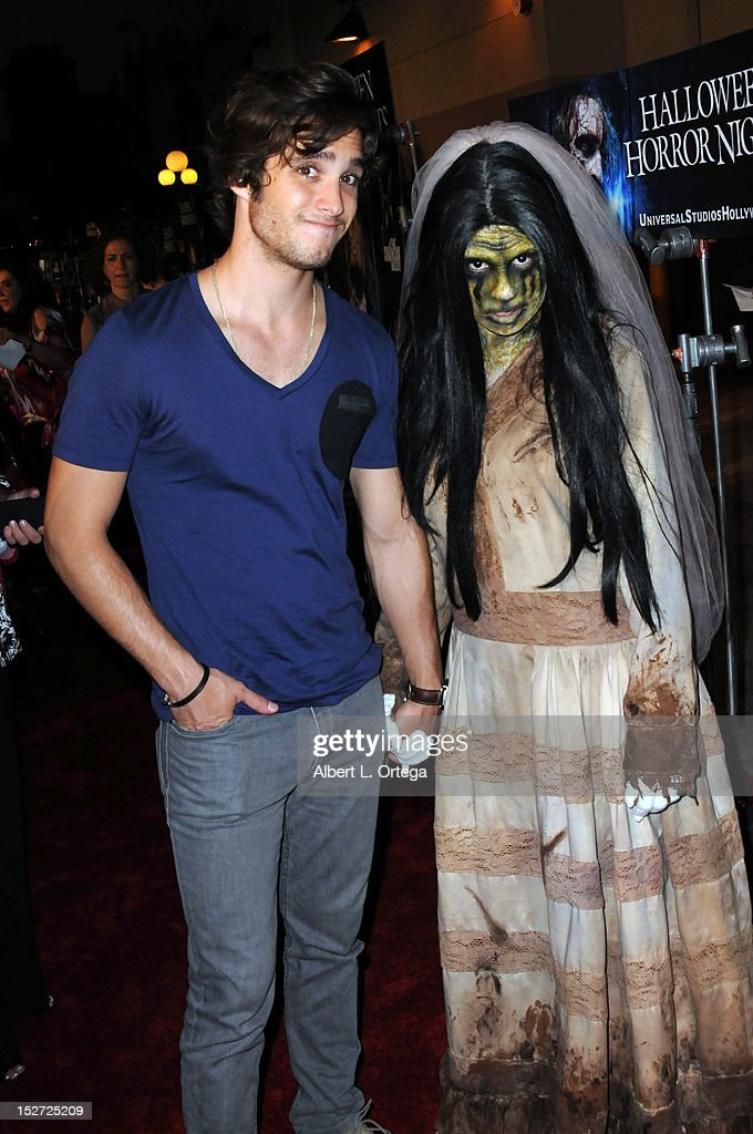 Actor <a gi-track='captionPersonalityLinkClicked' href=/galleries/search?phrase=Diego+Boneta&family=editorial&specificpeople=6787641 ng-click='$event.stopPropagation()'>Diego Boneta</a> poses with La Llorona for Universal Studios Hollywood 'Halloween Horror Night' and Eye Gore Awards Kick Off Party held at Universal Studios Hollywood on September 21, 2012 in Universal City, California.