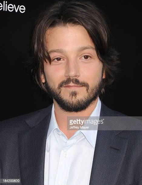 Actor Diego Luna arrives at the Los Angeles premiere of 'Elysium' at Regency Village Theatre on August 7 2013 in Westwood California
