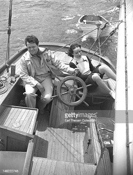Actor director and writer Orson Welles and Mexican actress Dolores Del Rio sail to Catalina Island off the coast of California circa 1940
