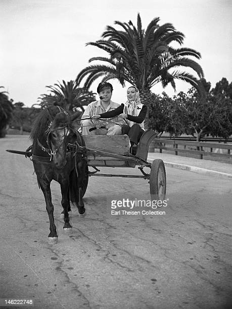 Actor director and writer Orson Welles and Mexican actress Dolores Del Rio ride in a poney cart on Catalina Island off the coast of California circa...