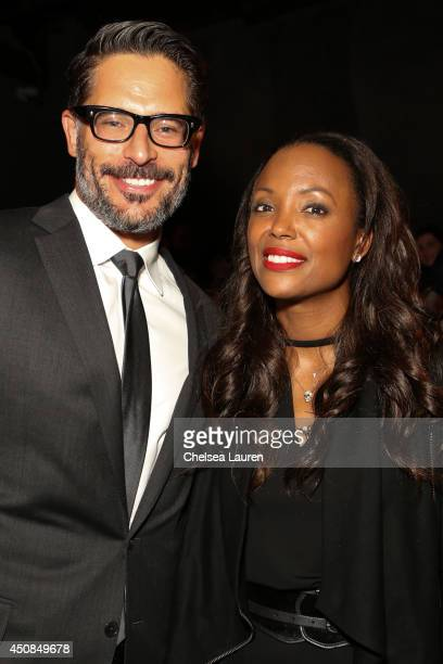 Actor / director Joe Manganiello poses with actress Aisha Tyler at the 'La Bare' premiere after party on June 18 2014 in Los Angeles California